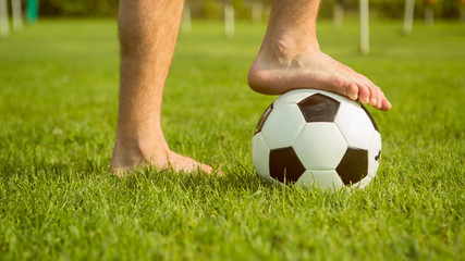 man barefoot on soccer ball outdoor prepare to play friendly match
