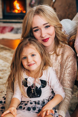 beautiful blonde posing for the camera with a child