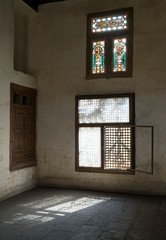 Old abandoned dark damaged dirty room with two wooden broken ornate windows