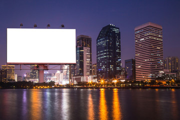 lake in the night city with white blank billboard