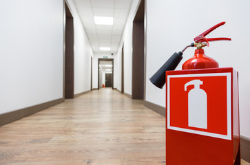Fire extinguisher in business center corridor