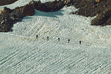 Group of Tourists on the Snowfield