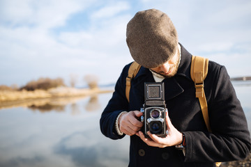 Photographer with vintage photo camera
