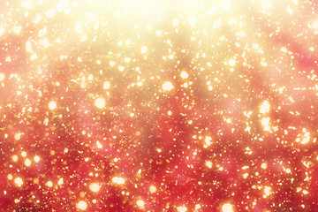 Red  Abstract Christmas Background with Rays and Golden circle glitter or bokeh lights. Round gold defocused particles