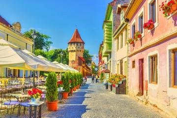 Little square and The Carpenters' Tower in Sibiu city, Transylvania region, Romania. Wall mural