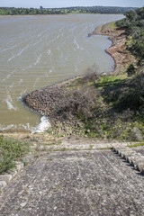 Dam of Cornalvo Reservoir from top of the wall, Extremadura, Spain