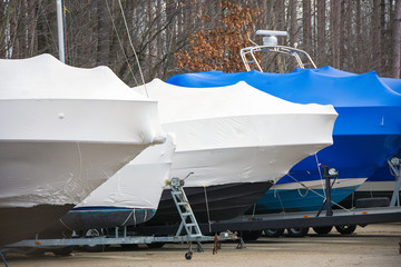 shrink wrap on sailboat and power boat