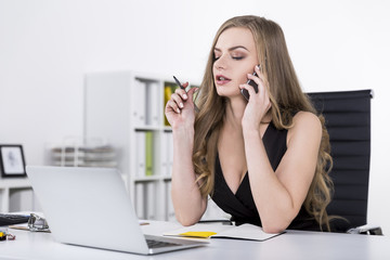 Businesswoman in a dress on a phone
