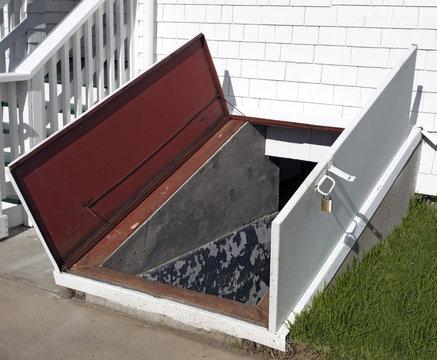 Open door to storm cellar.