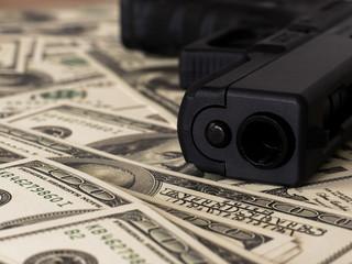 Gun on US dollar banknotes, crime and corruption.