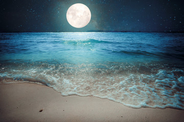 Beautiful fantasy tropical beach with star and full moon in night skies - imagine style artwork with vintage color tone