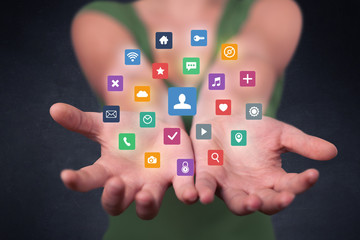 Woman holding colorful applications