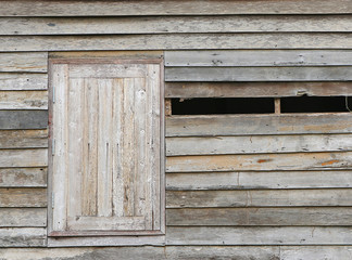 Old abandoned wooden house with broken