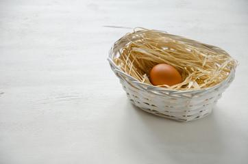 Basket with beige egg