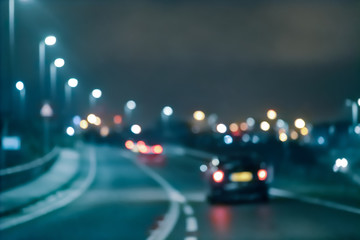Abstract blurred background.  Car on the road at night
