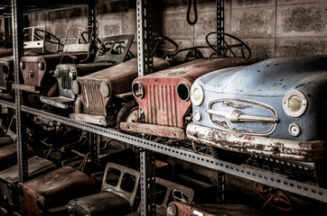 Old metal pedal cars toys for kid, nostalgia for a time which has passed, vintage background