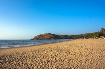 The main town beach of Gokarna, India, a lot of yellow sand and few people