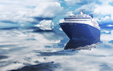 The cruise ship sails between the clouds. Luxury cruise ship floating on the ocean. A large boat for traveling around the world.