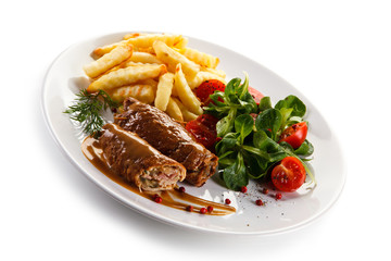 Wrapped pork chops with french fries