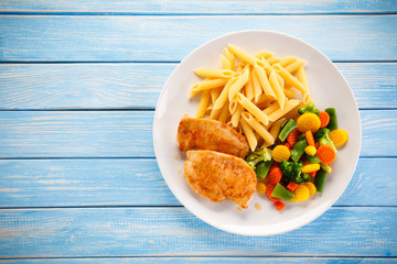 Fried chicken fillets with pasta