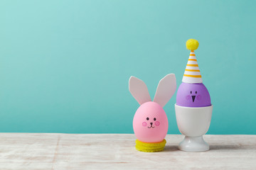 Easter holiday concept with cute handmade eggs over blue background