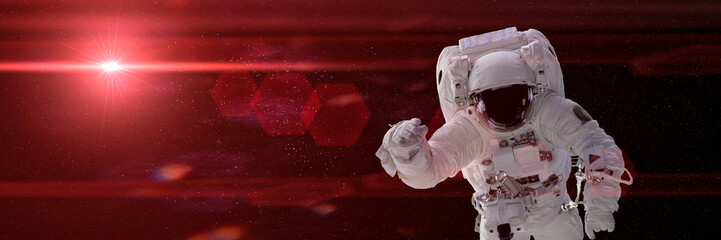astronaut hovering in space lit by a bright red star (3d illustration, background banner, elements of this image are furnished by NASA)