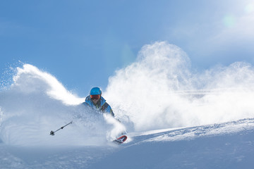 Powder turn in the Swiss Alps Wall mural