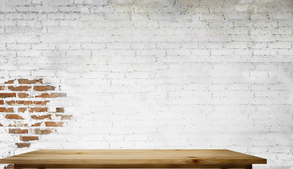 Empty top wooden table with white brick wall. For product display montage.