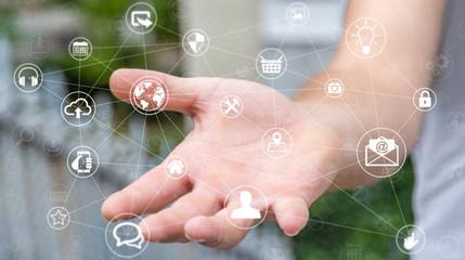Businessman holding multimedia network 3D rendering