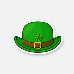 Vector illustration. Front view of bowler hat with buckle and clover. Saint Patrick's Day symbol. Sticker in cartoon style with contour. For greeting cards, patches, prints for clothes, badges