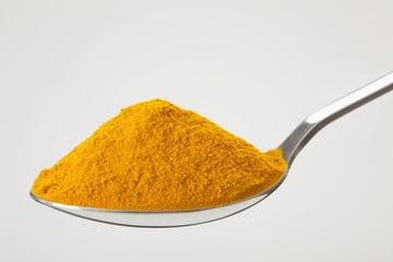 Fototapeta spoon of ground, powder turmeric obraz