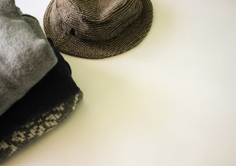 Autumn cozy clothes, sweaters and vintage hat on white background for fashion blog