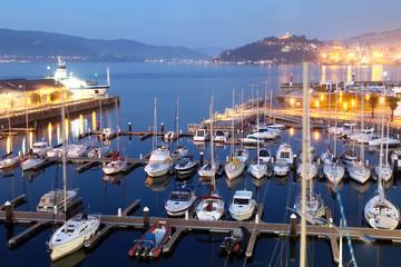 marina with vessels at night in the coast of Galicia, Vigo, with illumination