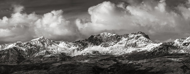 Snow covered Piolit and Parias mountain peaks (Black & White). Winter in Hautes Alpes, Southern French Alps, France