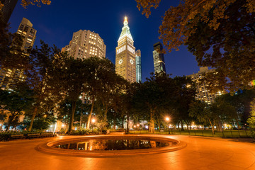 Madison Square Park in summer at twilight. Midtown skyscrapers, Manhattan, New York City