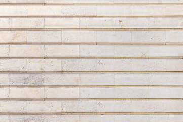 Big light yellow stone building wall texture