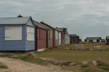 Multi cloured beach huts at Jurassic Coast, Dordet, England
