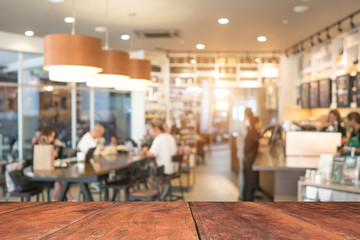 Coffee shop blur background with bokeh image .