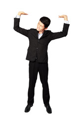 Handsome businessman in suit his arms up with heavy concept on white background
