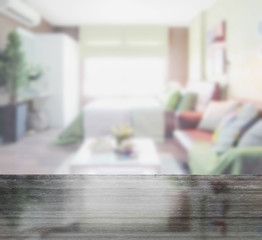 black granite table top and blur of colorful bedroom with sofa