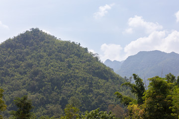 Bright green hill in sunny weather in Thailand