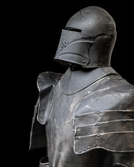 The iron armor for a knight on a black background