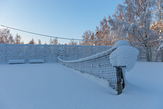A snow covered tennis net