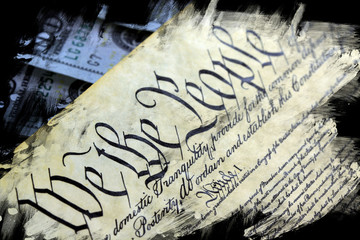 US Constitution with One Hundred Dollar Bills sitting above