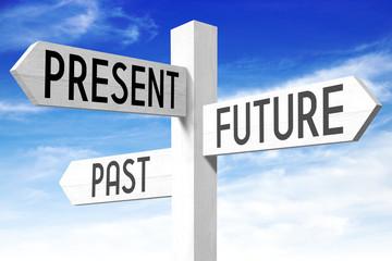 Future, present, past - wooden signpost