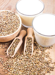 Hemp milk, seeds on wooden background . Close Up .