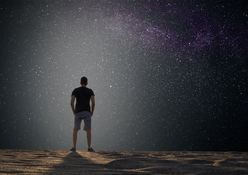 Guy on other planet standing and watching stars