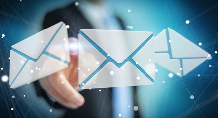Businessman touching 3D rendering flying email icon with his finger