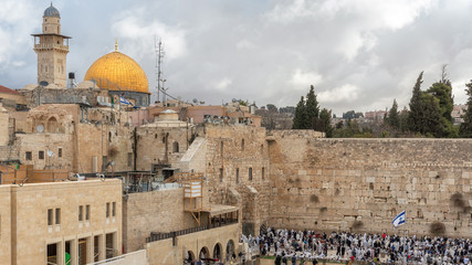 The Western Wall and golden Dome of the Rock on the Temple Mount, Jerusalem, Israel.