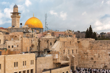 A view of Temple Mount in the old city of Jerusalem, including the Western Wall and golden Dome of the Rock, Jerusalem, Israel.